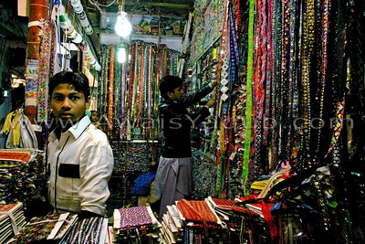 Inside Rangeela bazzar a shop of laces that women put on their cloths shot this picture it came out totaly dark had to use PS