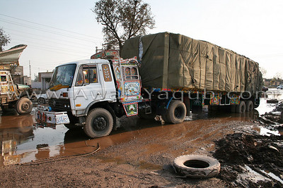 This huge loaded truck was stuck in mud Place called Jhang